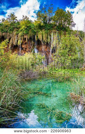 Overgrown Lake And Waterfalls In Plitvice Lakes National Park, Croatia