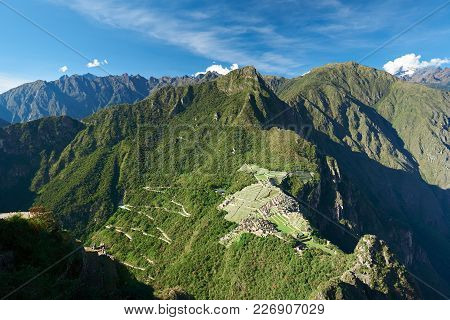 Machu Picchu Heritage On Mountain Landscape In Sunny Day With Blue Sky