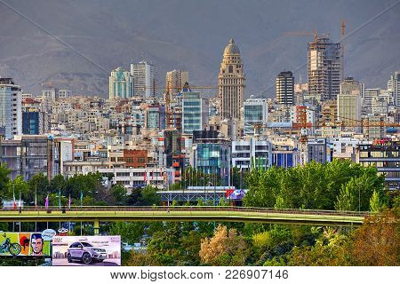 Tehran, Iran - April 28, 2017: A View Of The Pedestrian Abo Atash Bridge And Multi-storey Buildings