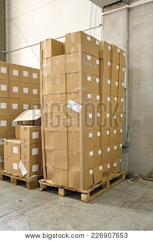 Boxes With Goods At Pallets In Distribution Warehouse