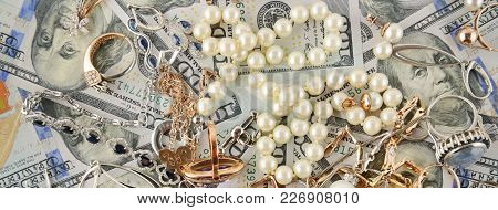Background Of American Dollars And Jewelry. Flat Lay, Top View. Wide Photo