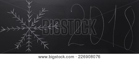 Drawn Snowflake With Chalk On Blackboard With Year 2018