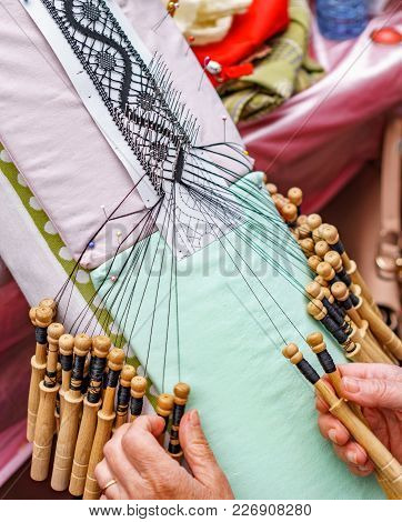 Detailed Top View Of An Elderly Woman Hands Working With Bobbin Lace