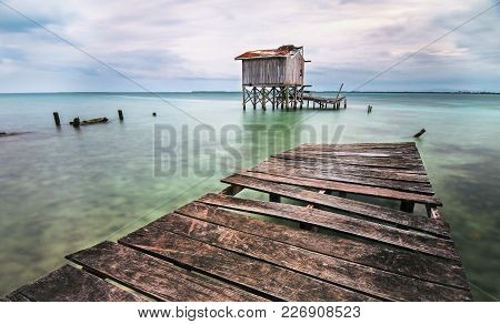 A Long Exposure Of The Caribbean Sea From A Dock. Taken On Tobacco Caye, Belize.