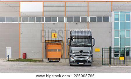 Loading Truck At Warehouse Dock Door Bay