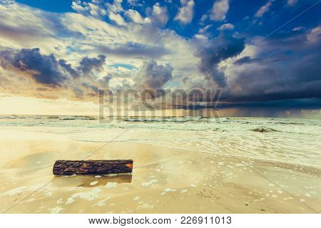 Amazing Colorful Sunset Over Evening Sea Horizon, Clouds Sky And Sandy Beach. Tranquil Scene. Natura