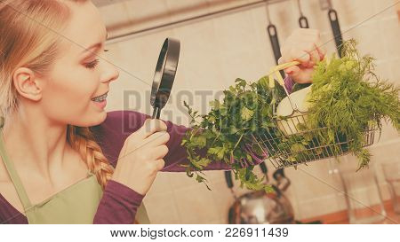 Buying Healthy Dieting Food Concept. Woman In Kitchen Having Many Green Vegetables Looking Through M