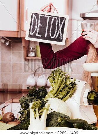 Dieting And Detoxing, Weight Loss Concept. Woman Holding Board With Detox Sign