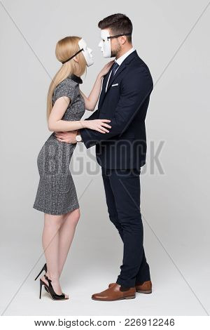 Man And Woman In Mask Hiding Real Personality In Front Of Each Other Concept