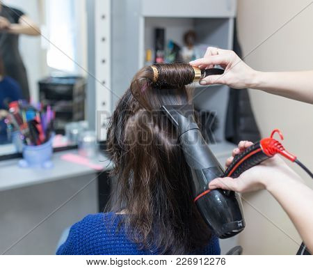 Blow-drying In A Beauty Salon . Photos In The Studio