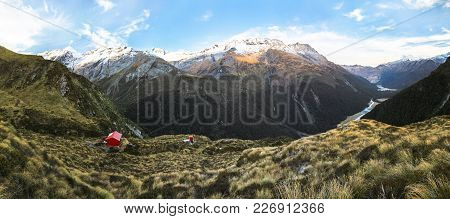 Liverpool Hut Rests On The Edge Of A Large Cliff With Mt. Aspiring In The Distance. Matukituki Valle
