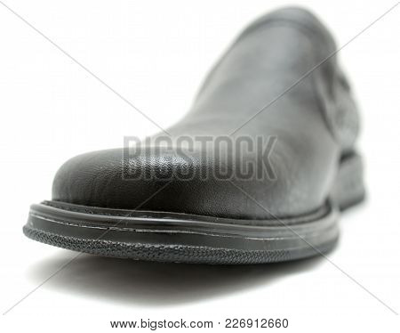 Black Shoes On A White Background . Photos In The Studio