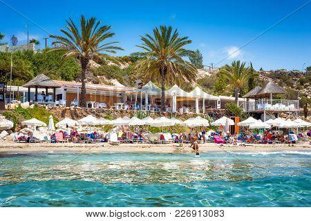 Paphos, Cyprus - July 24, 2016: People Enjoying Nice Summer Day At Coral Bay Beach