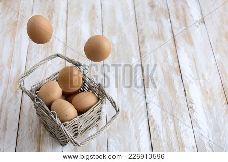 Eggs In A Basket Wooden Background, Easter Concept