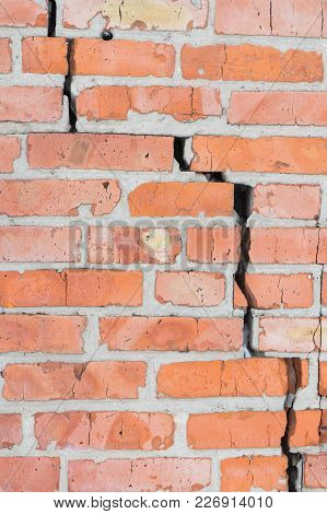 Old Brick Wall With Cracks. Wall Of Red Brick.
