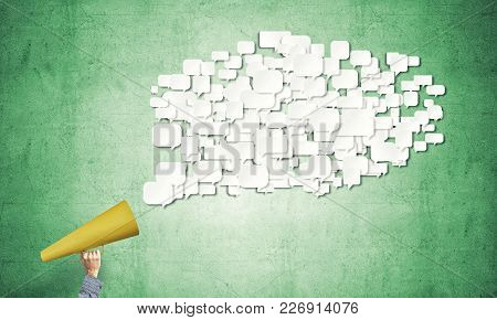 Close Of Man Making Announcement In Paper Trumpet
