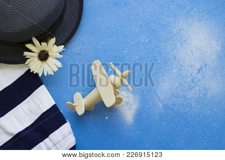 Being A Romantic. Tourist Or Travel Concept. Blue Powdered Background With Striped Clothing, Grey Ha
