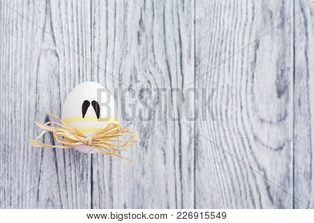 Funny Colorful Egg With Mustaches On Wooden Background, Easter Concept