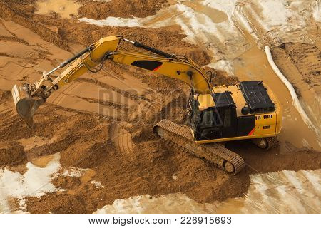 Working Excavator Tractor Digging A Trench.