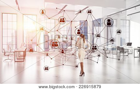 Elegant Businesswoman In Modern Office Talking Mobile Phone And Social Connection Concept. Mixed Med