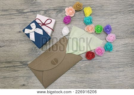 Rose Flowers Out Of A Forgive Me Letter. Flat Lay Image
