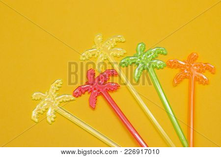 Cocktail Sticks On Bright Yellow Background, Close Up. Party And Celebration Concept. Space For A Te