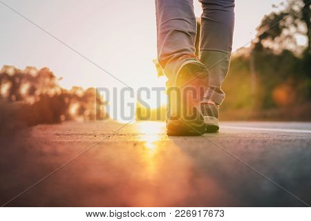 Man Runner Running On Road With Sun Light Flare , Close Up On Shoe Jogging Workout Wellness After Wo