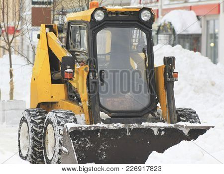 Clearing Snow From The Road With Bulldozer In The City, Urban Landscape