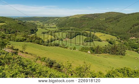 Welsh Landscape With The Sea In The Background Near Nant Yr Arian, Ceredigion, Dyfed, Wales, Uk