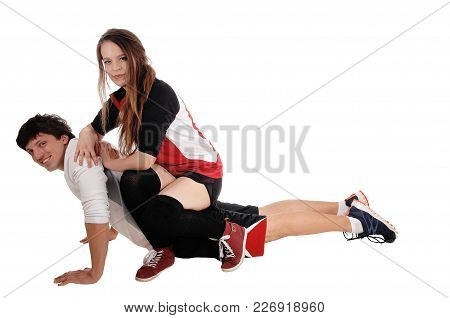 Young Couple Playing In Exercise Outfits