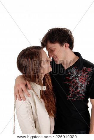 A Beautiful Young Couple Standing Isolated For White Background Looking And Smiling At Each Other