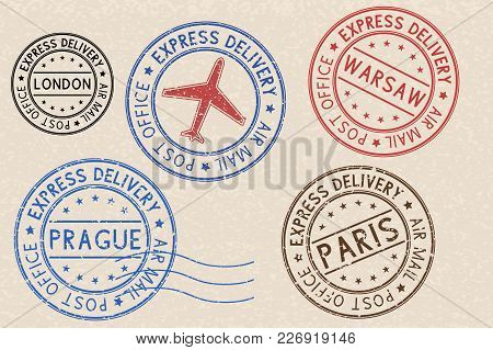 Set Of Colored Ink Postmarks With European Cities. On Beige Background. Vector Illustration