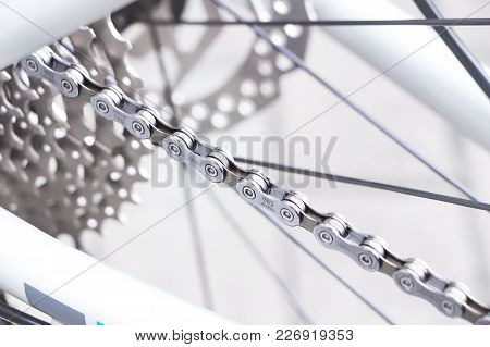 Frankfurt / Germany - Jul 15 2017: Mountain Bike Wheel And Metal Chain Rings Detail With Shimano Deo