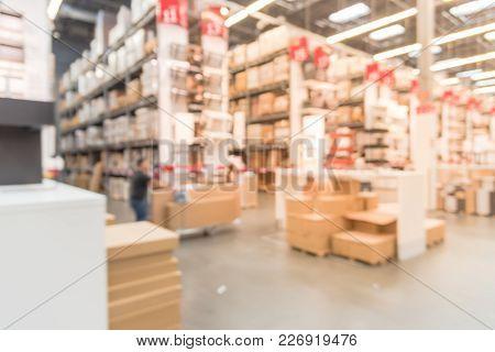 Abstract Blur Customer Shopping At Furniture Warehouse In Usa