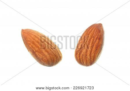 Isolated Almond Seed, Top View Closeup Photo Of Two Almond Nuts Isolated On A White Background Prese