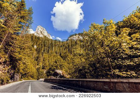 Road In Mountains. Bicaz Canyon In Fall Season. Potentially Dangerous Hairpin Curve On A Mountain Ro
