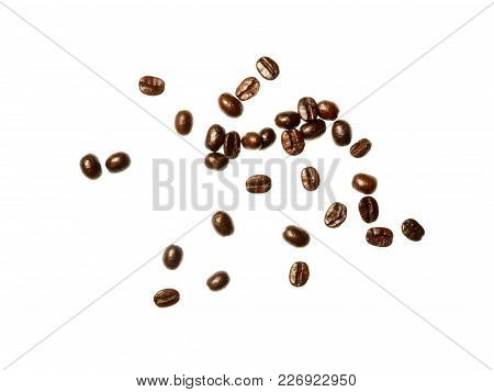 Isolate Coffee Beans, A Top View Closeup Photo Image Of Scattered Dark Roasted Coffee Beans Isolate