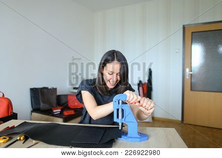 Young Woman Working With Strap At Clothing Repair, Man Requested Master To Change Snap On Belt. Conc