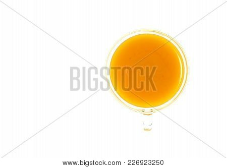 Isolate Turmeric Drink, Isolate Curcuma Tea, Top View Closeup Photo Of Glass Cup Of Yellow Turmeric/