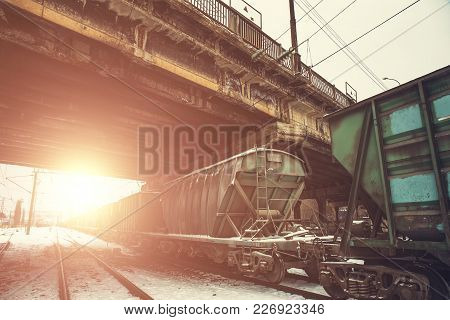 Tanks Or Wagons With Gas Or Oil Or Coal Transportation By Railroad At Sunset, Toned