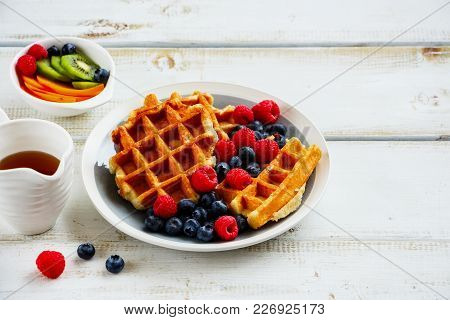 Tasty Breakfast Set. Warm Homemade Traditional Belgian Waffles With Fresh Berry And Maple Syrup On W