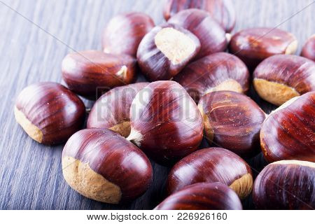Chestnuts Spread Over Wooden Table