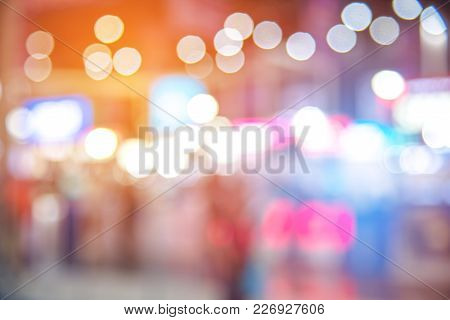 Abstract Blurred Of Festival Event With People And Motor Show Background. Convention And Business Ev