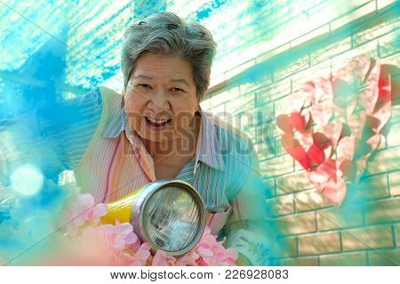 Elder Woman Riding Motorcycle. Happy Elderly Female On Motorbike. Fun Mature Lifestyle Concept