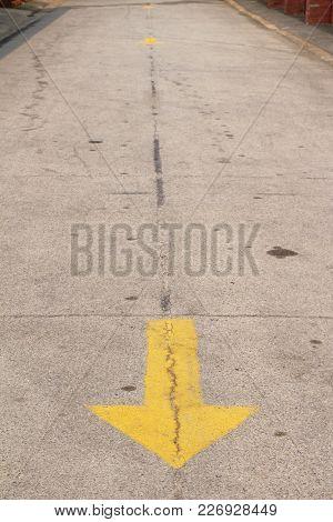 Yellow Arrows On The Street On Ground