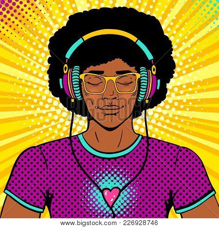 Young Sexy Man With Afro Hairstyle, Smile And Closed Eyes In Brighy Glasses And Headphones Listening