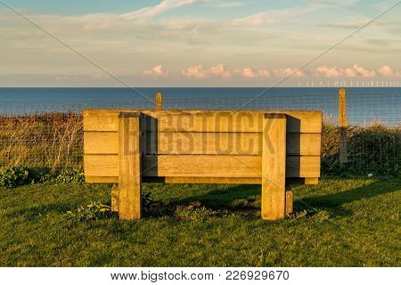 A Large Bench With A View Over The North Sea And Some Wind Turbines, Seen At Botany Bay In Kingsgate