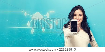 Cloud Computing With People With Young Woman Holding Out A Smartphone In Her Hand