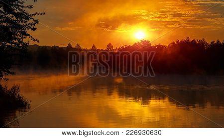 Wonderful Misty Evening. Majestic Golden Sunset Over The Foggy Lake. Picturesque Dramatic Scene. Unu