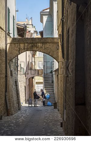 Historic Buildings Of Foligno, Perugia, Umbria, Italy. Old Typical Street In The Medieval Quarter